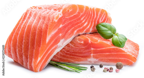 Fresh raw salmon fillets with herbs and spices.