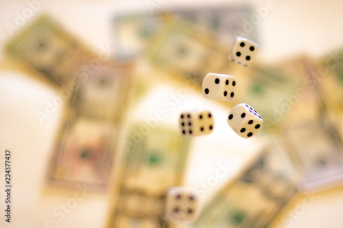 фотография  Gambling addiction. Let`s play a diced game. Dice in mid air