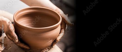 Fotografiet  Hands of potter making clay pot, closeup