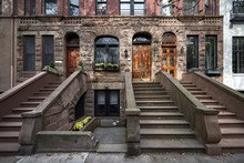 A Row Of Colorful Brownstone B...