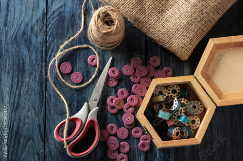Accessories for sewing and needlework  a casket with bobbins