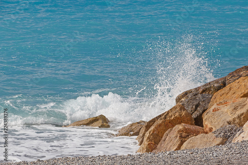 Keuken foto achterwand Water splash of wave against wavebreaker on beach in Nice, France