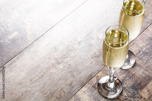 Champagne glasses on wooden table Copyspace