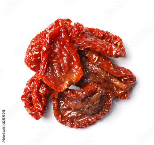 Tasty sun dried tomatoes on white background, top view