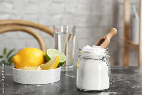 Photo Jar with baking soda and lemons on table indoors