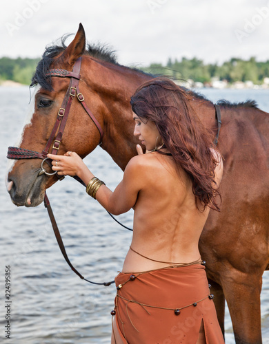 Keuken foto achterwand Akt horse and young beautiful naked Amazon woman on river beach
