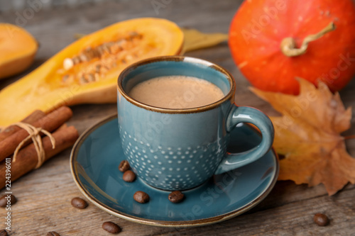 Cup with tasty pumpkin spice latte on wooden table Wallpaper Mural