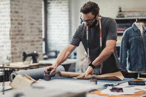Obraz Fashion designer working in his studio - fototapety do salonu