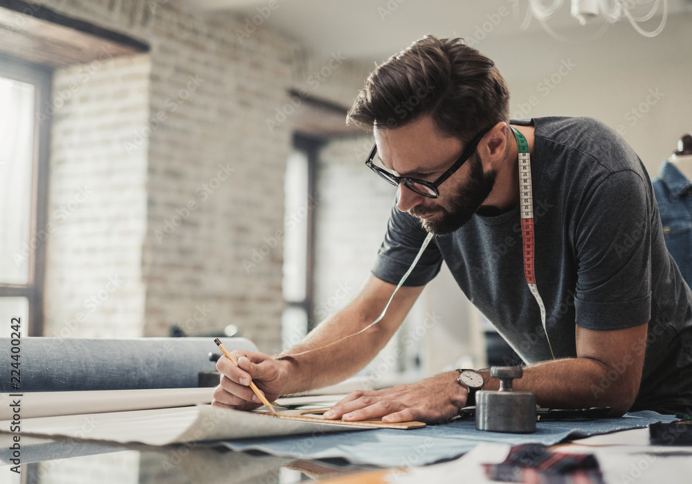 Fototapety, obrazy: Fashion designer working in his studio