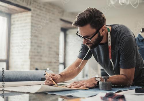 Fotografie, Obraz Fashion designer working in his studio