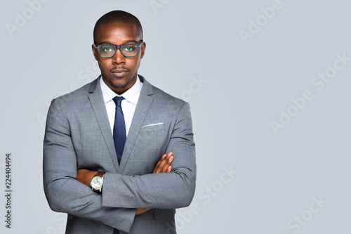 Fotografiet  Isolated serious african american business man, lawyer, attorney looking strong