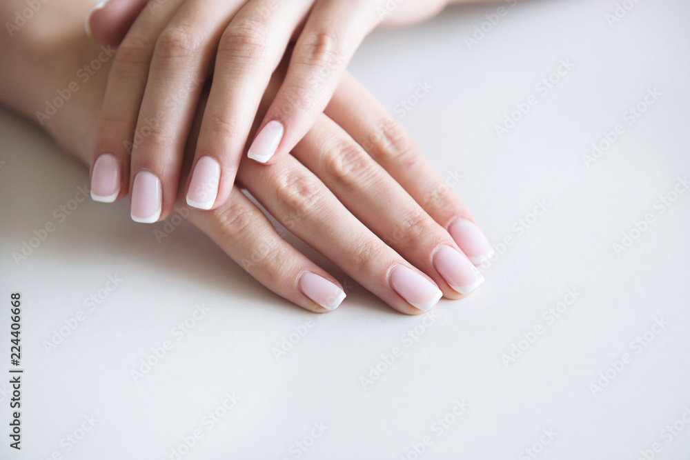 Fototapety, obrazy: Manicured hands on towel. French manicure.