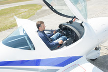 Downward View Of Man In Cockpit Of Aircraft