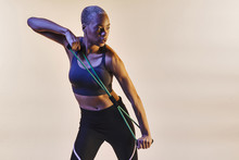 Woman Stretching Resistance Band And Looking To Side