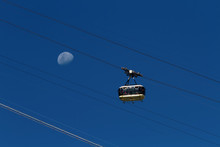 Sugarloaf Mountain Cable Car Full Of Tourists With Crescent Moon Background (Rio De Janeiro, Brazil)