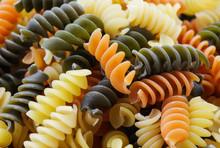 Uncooked Multi-colored Rotini Pasta -closeup