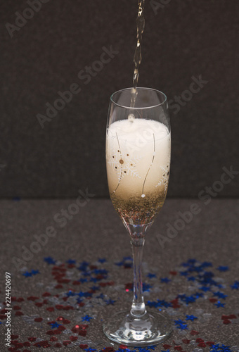 Foto op Plexiglas Alcohol Glass of Champagne and Confetti in Form of Stars and Heart. Top View. New Year Сoncept