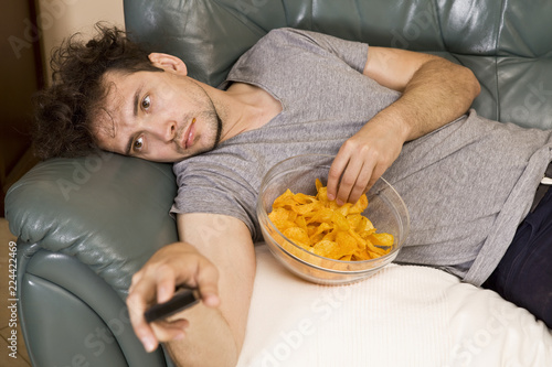 Obraz Man's relax after work, beer and chips. Lazy man - fototapety do salonu