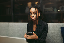 Portrait Of Young Businesswoman Using Smartphone In The Office