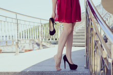 Relief New Shoes Feeling Discomfort Too Small Size Girlish Feminine Problem Concept. Side Profile Front Close Up Lifestyle View Photo Of Beautiful Pretty Happy Student Holding Black High Heels In Hand