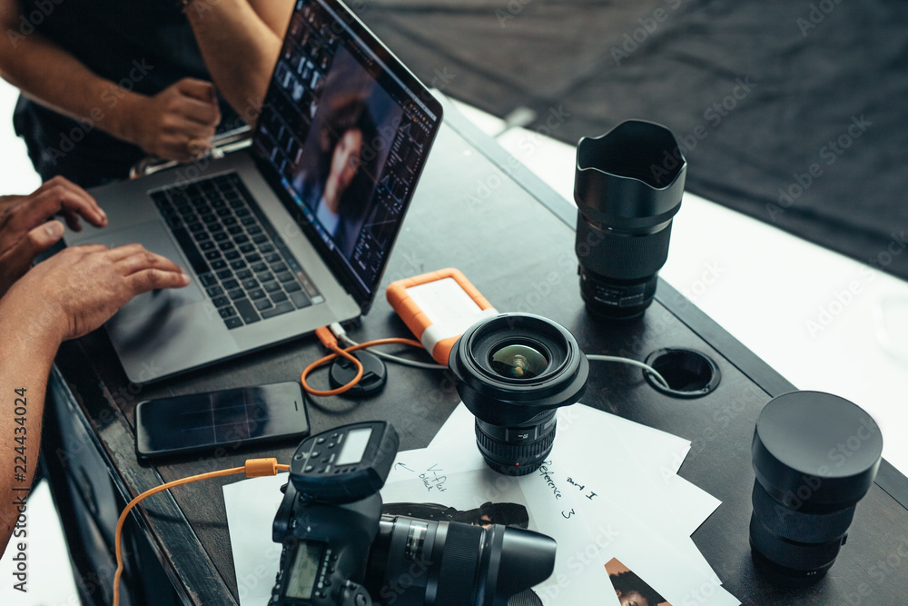 Fototapety, obrazy: Equipments of a photographer on a table