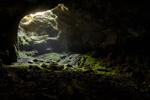 Dark Cave With A Bright Daylight Spot Of Exit