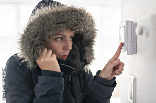 Canvastavla Woman With Warm Clothing Feeling The Cold Inside House
