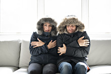 Couple Have Cold On The Sofa A...