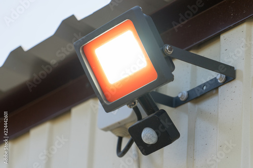 Fotografie, Obraz  Led spotlight with motion sensor. Place for your text.