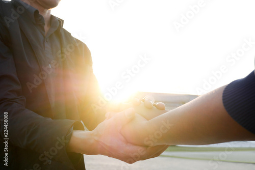 Cuadros en Lienzo Woman and man holding hands to take care and help each other.