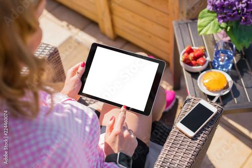 Woman using tablet computer, horizontal screen mockup