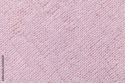 Staande foto Macrofotografie Light pink background closeup. Structure of the fabric macro