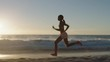 young african american woman running on beach sprinting exercising intense cardio workout competitive black female training early morning seaside sunrise