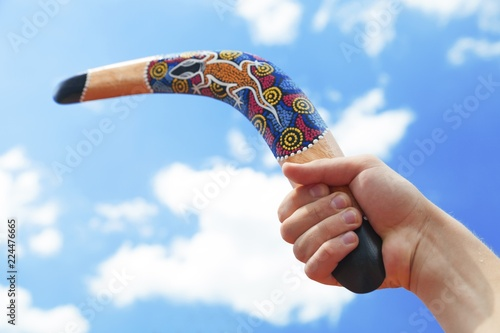 фотография  Wooden Boomerang with Blue Sky and Cloud Background