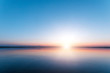 canvas print picture - Beautiful, red dawn on the lake. The rays of the sun through the fog. The blue sky over the lake, the morning comes, the sky is reflected in the water.