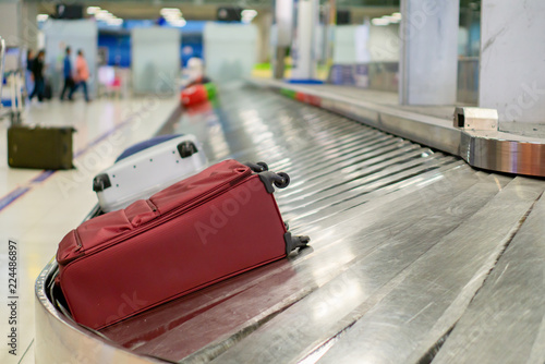 traveler waiting for luggage at Point of checking the scanner After