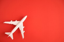 Airplane Model. White Plane On Red Background.