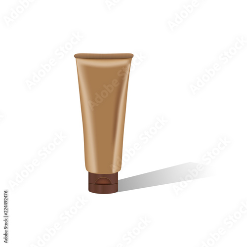 Photo Brown cosmetic tube with shadow on white background