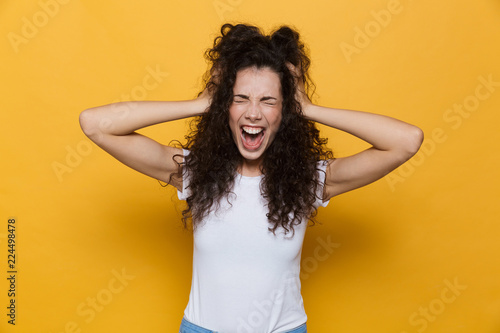 Fototapeta Screaming excited young cute woman posing isolated over yellow background. obraz na płótnie