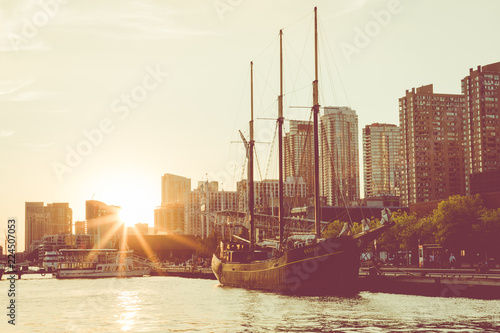 Sunset at the Ontario lake with tall ship standing at marina in Toronto, Canada.