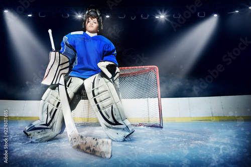 Young goalie in the spotlight of ice hockey arena