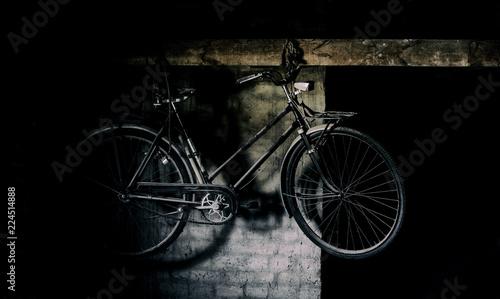 Fotobehang Fiets Retro vintage bike on black and white wall.