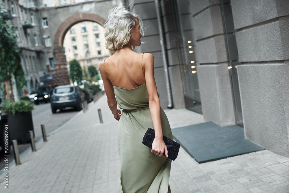 Fototapety, obrazy: Fashion. Young stylish woman walking on the city street back view windy weather