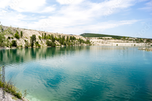 Bright blue water in the lake at the site of a limestone quarry