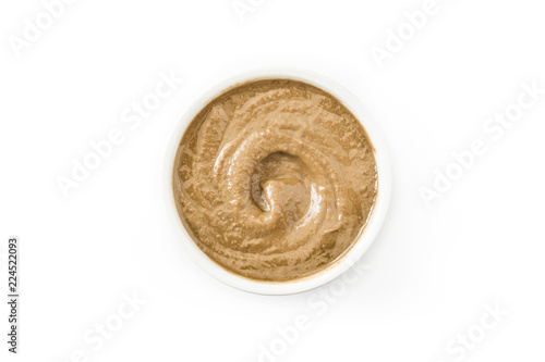 Obraz Tahini and sesame seeds isolated on white background. Top view - fototapety do salonu