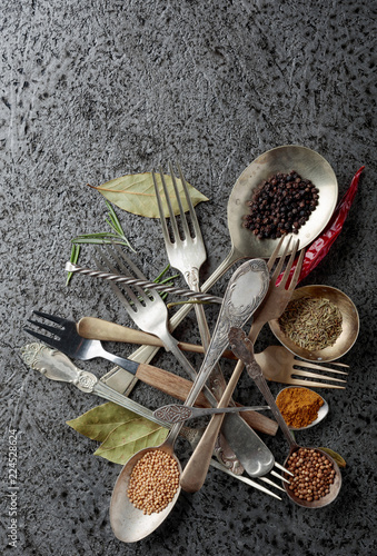 Various herbs and spices on metal table.