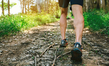 Detail Of Feet Of Young Man Participating In A Trail Race Through The Forest