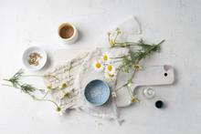 Chamomile Flowers, Globules, Tea And Salve Made Of Chamomile
