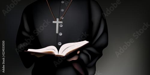 Carta da parati Un prêtre catholique en soutane tient la bible dans ses mains, pour prier Dieu