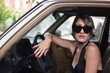 woman model driving retro car